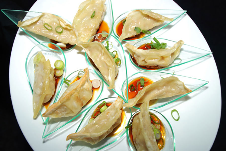Chicken Gyoza were served at Aston Martin unveiling at the Moore Building Miami