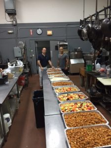 Preparing food for donation in Eggwhites kitchen
