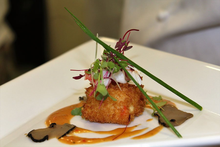 Crab and truffled arancini with red bell pepper sauce appetizer at Ritz Residences Miami Beach dinner