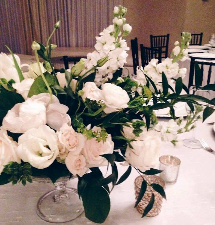 Classic and romantic all-white wedding flowers at The Bath Club