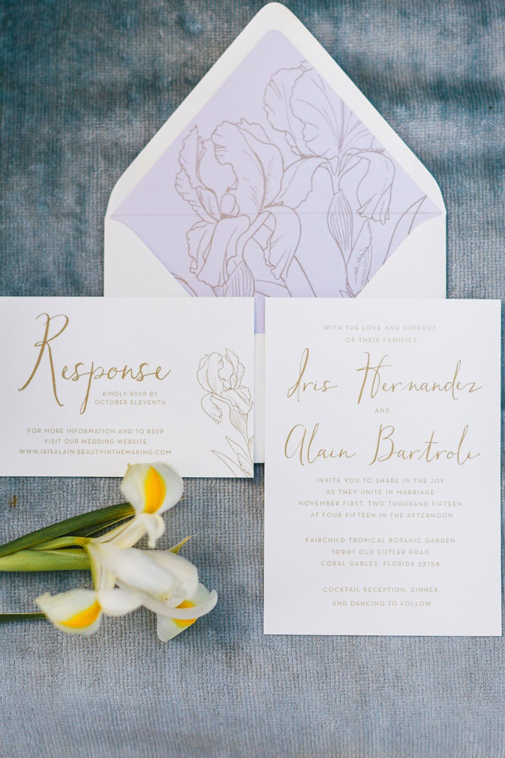 Wedding invitation with gold calligraphy and lavender accents