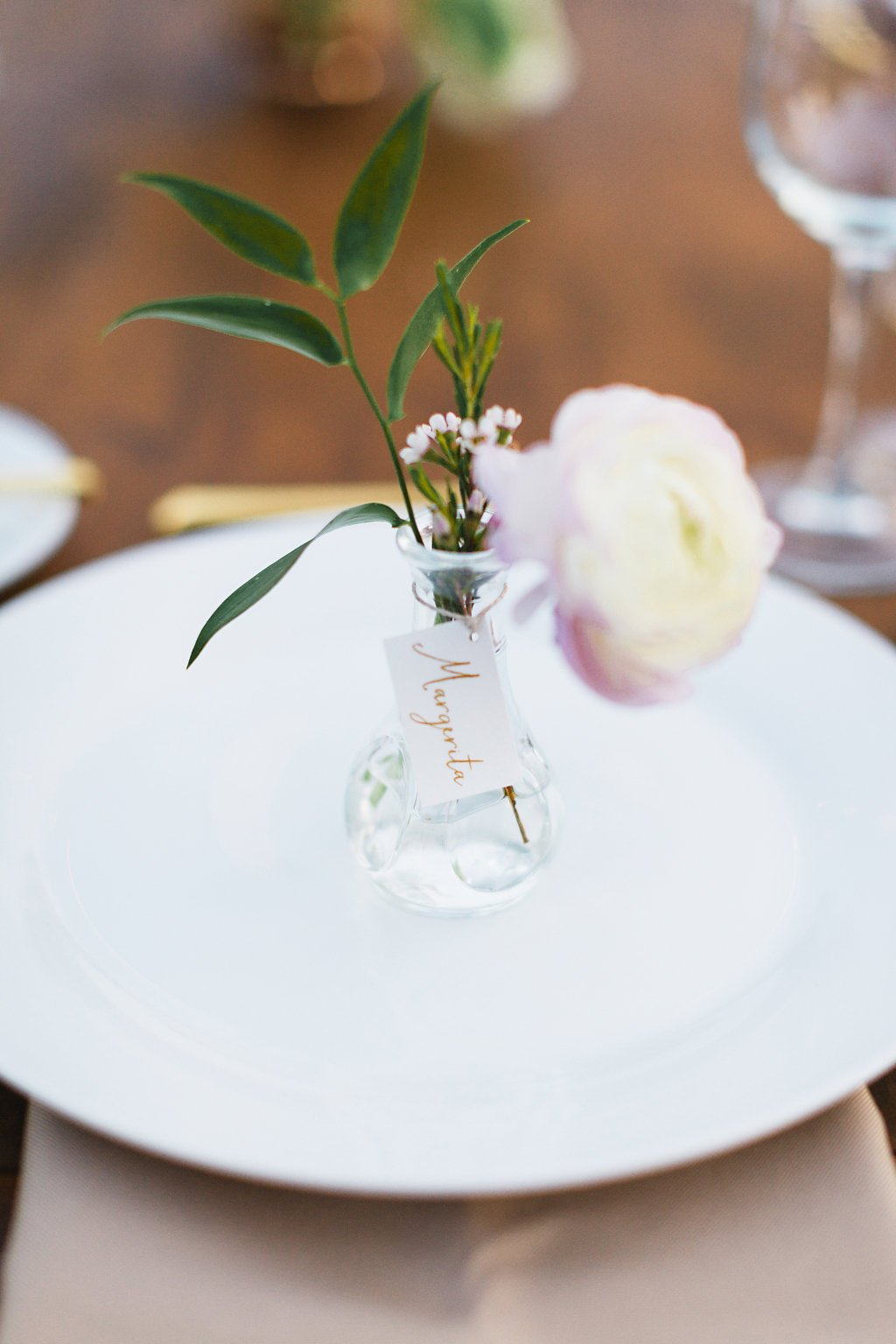 Delicate bud vase as place card holder
