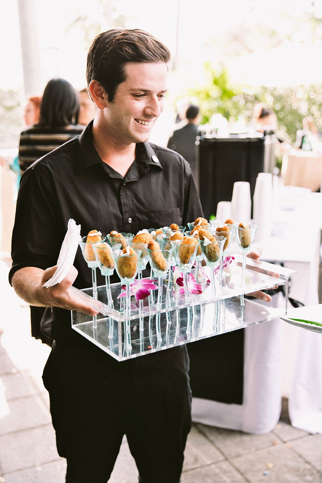 Eggwhites Catering server at at Hispanicize Miami 2017 at Hispanicize 2017 DiMe Summit cocktail reception