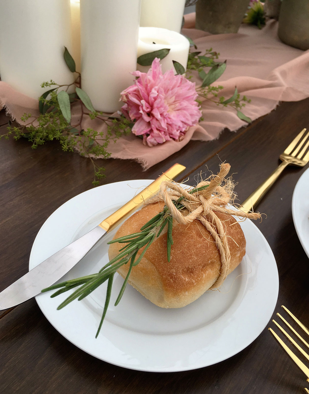 Dinner roll wrapped with rosemary and twine at Miami Seaquarium green wedding