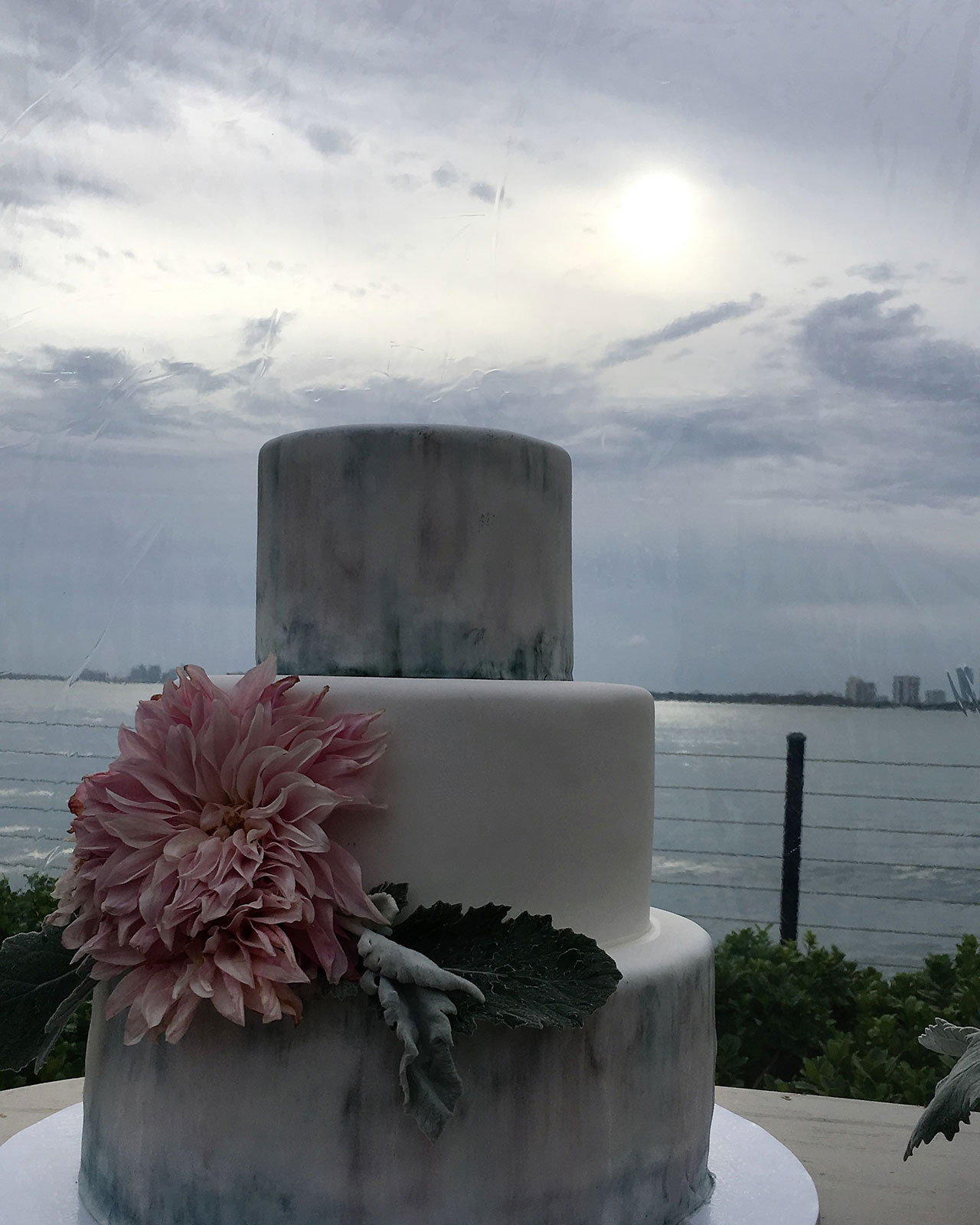 watercolor wedding cake with guava and oreo layers