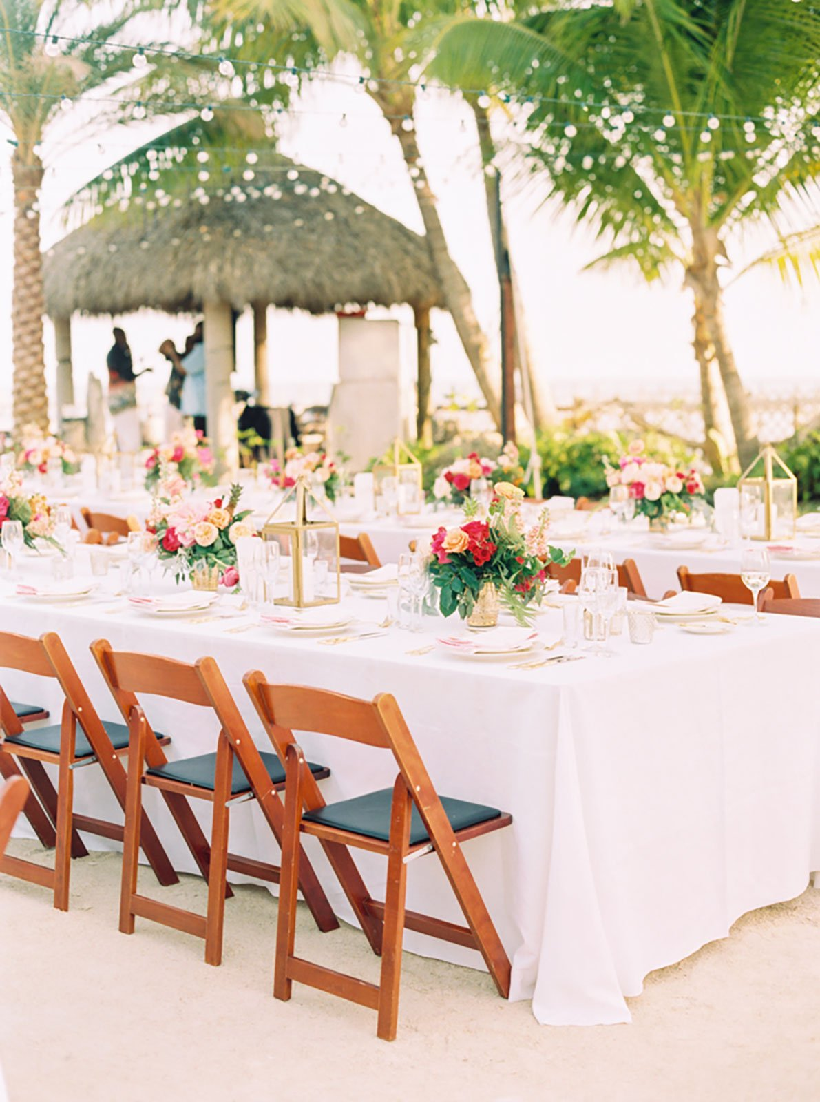 String lights were strewn over the reception to highlight the beach wedding space without obstructing views of the lush tropical landscape