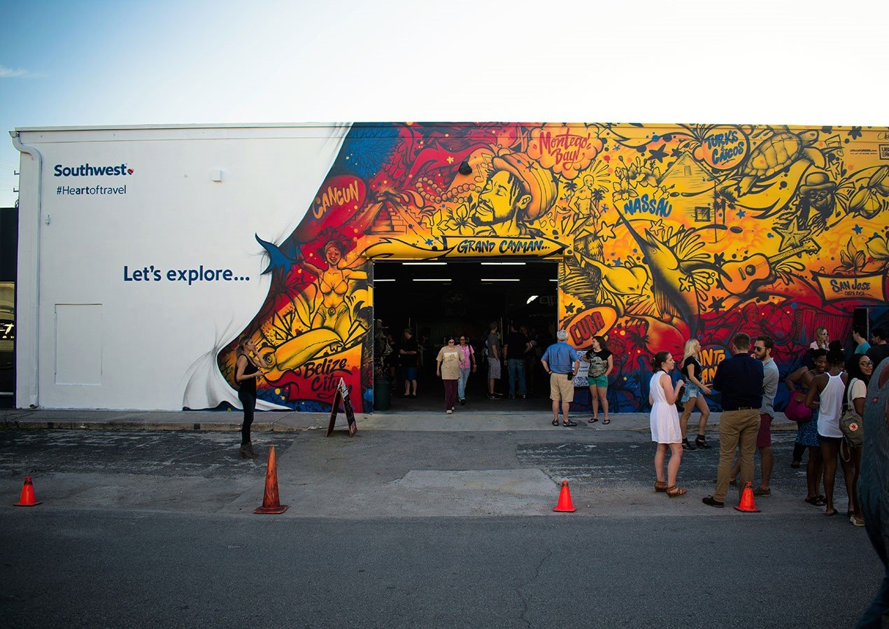 Southwest commissioned artist Ruben Ubiera to create an internationally inspired mural on FATVillage to celebrate their new international terminal at FLL