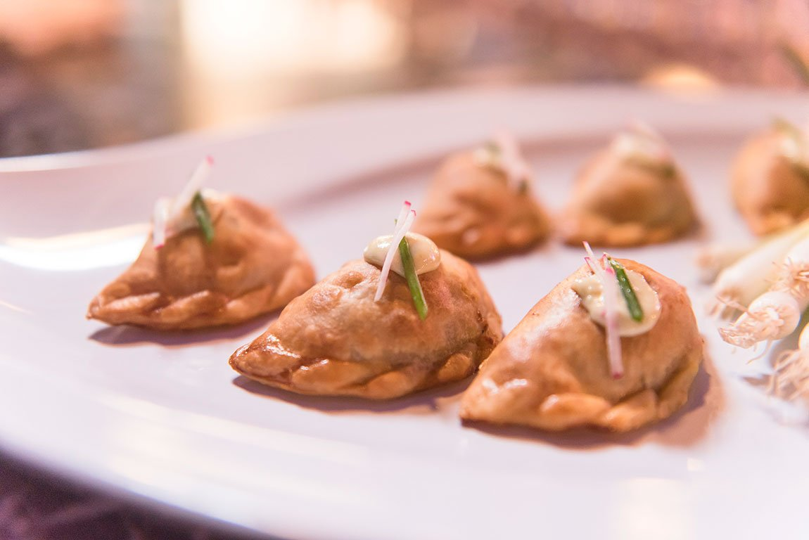 Eggwhites Special Events Catering served Mini Beef Empanadas with Green Chile Ribbon