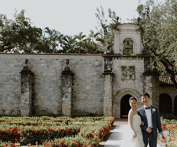 Bride And Groom In The Gardens At Their Ancient Spanish Monastery Wedding Miami