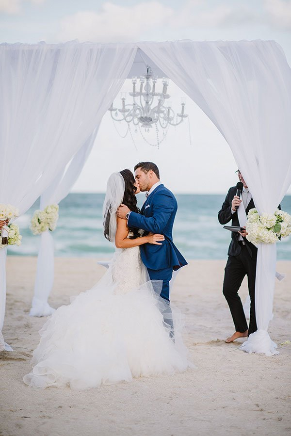 First kiss at beach ceremony at The Bath Club Miami Beach wedding