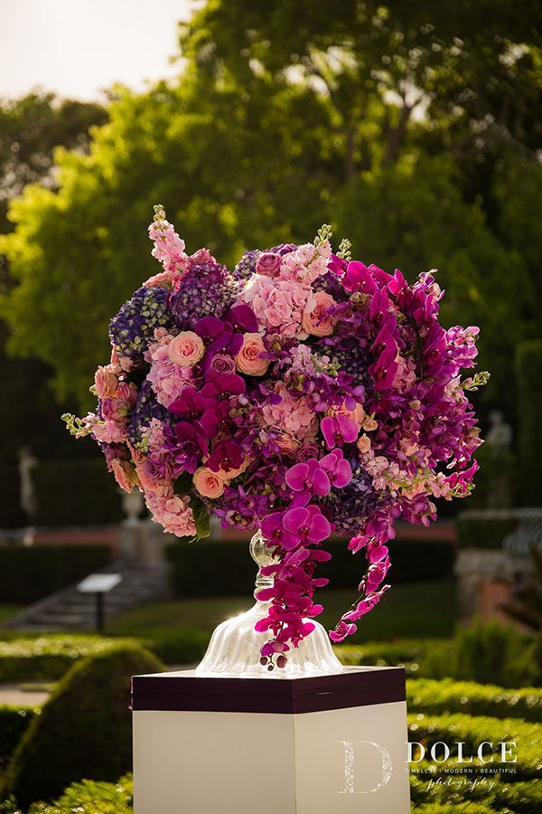 Wedding Ceremony Décor | Stunning floral pedestals in shades of pastel pink, fuschia, magenta and deeper tones of ultra violet at this romantic Vizcaya wedding