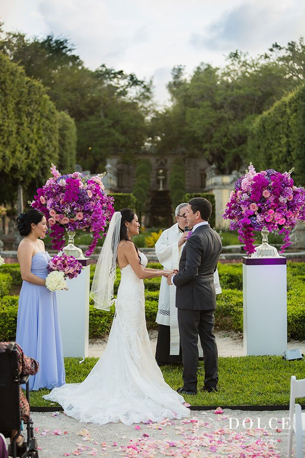 2018 Wedding Colors | Vibrant pink, purple and ultra violet floral urns add a pop of color to this Vizcaya wedding ceremony set-up