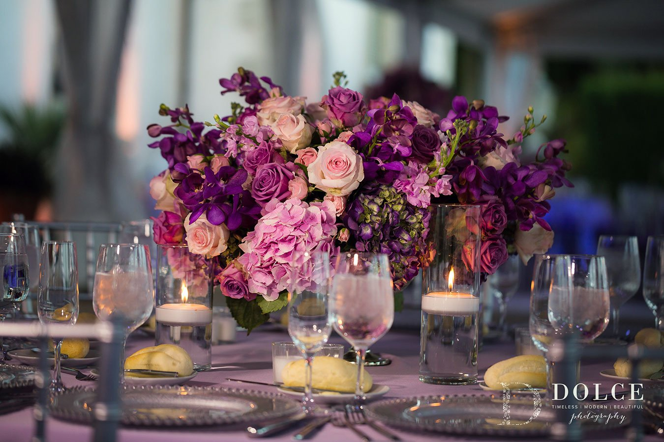 2018 Wedding Colors | Ultra Violet |Romantic floral centerpiece with shades of pink, purple and ultra violet hydrangea, orchids, garden roses and larkspur
