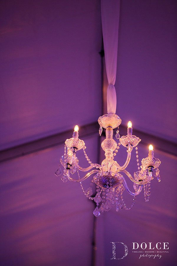Crystal chandeliers add height and drama to the reception tent
