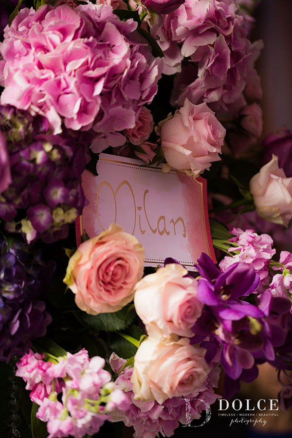 2018 Wedding Colors | Table signs were nestled in vibrant pink, purple and ultra violet flowers. Table names were all locations special to the couple.
