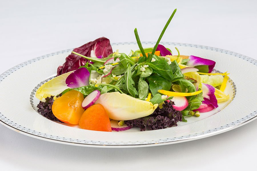 Salad Greens with Apricot, Radish, Saga Blue Cheese and Violet Edible Flowers