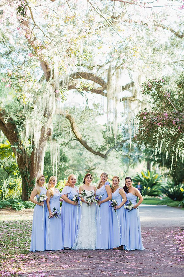 Bridesmaids in lavender dresses at Fairchild Garden wedding