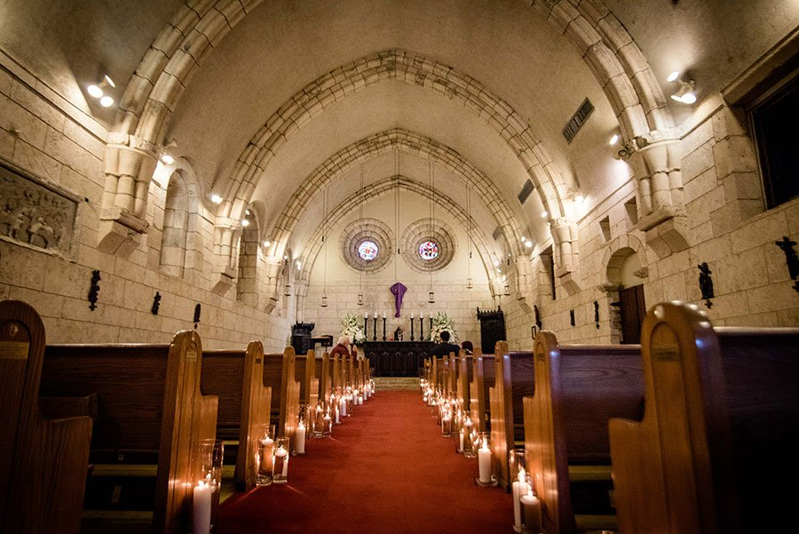 eco friendly wedding ideas | candlelit wedding chapel