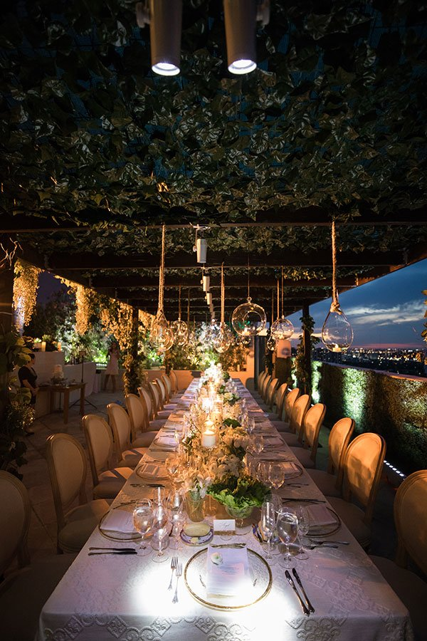 wedding themes | tropical wedding reception hanging greenery