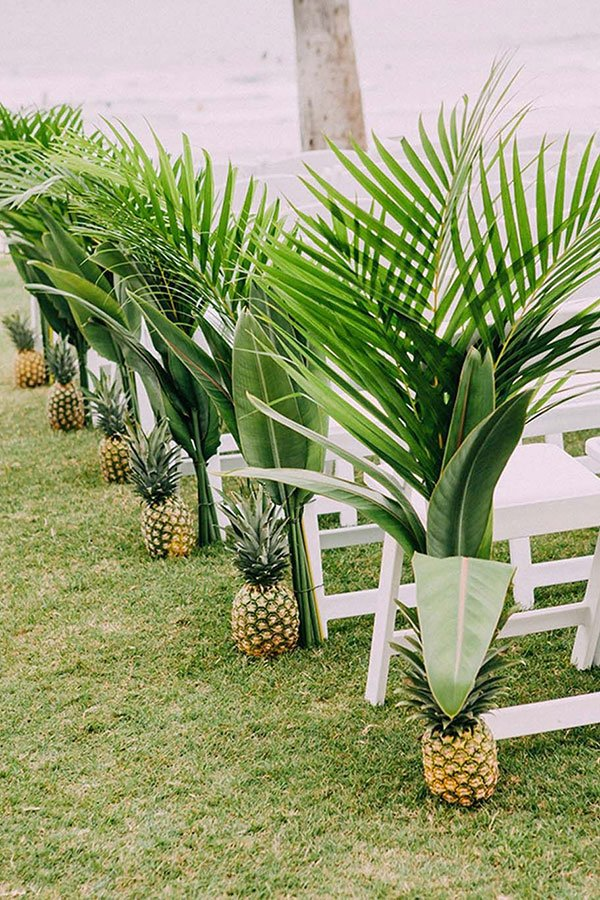tropical wedding reception ideas | pineapple palm frond aisle decor
