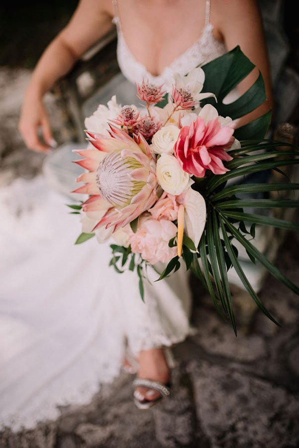 Protea and alpinia tropical wedding bridal bouquet | tropical wedding flowers