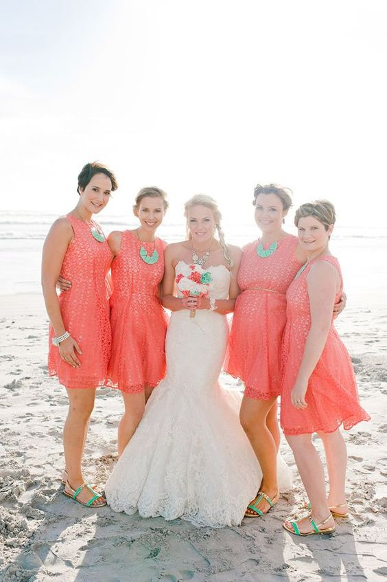 unique wedding color schemes | coral and turquoise bridal attire