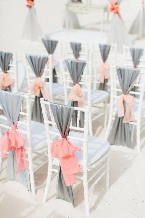 different wedding color schemes | grey and coral ceremony chairs