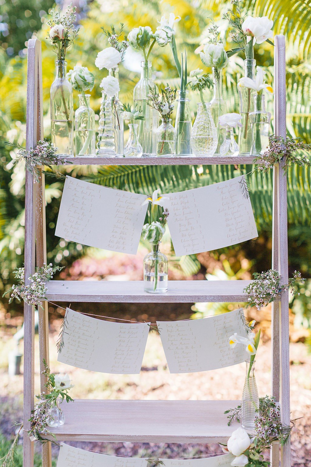 unique wedding seating chart ideas | ladder book shelf