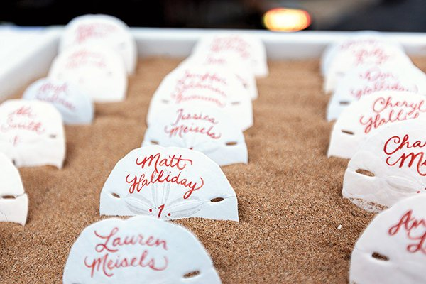 unique seating chart ideas | sand dollars in sand box for beach wedding