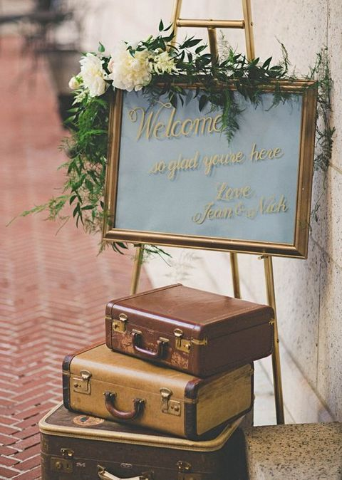 travel wedding shower theme | welcome sign with suitcases